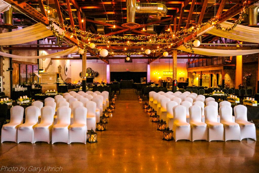 Beautiful Wedding Ceremony Setup Covered Chairs Lights Greenery